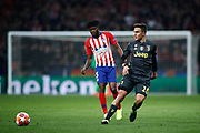 Paulo Dybala of Juventus and Thomas Teye of Atletico de Madrid during the UEFA Champions League, round of 16, 1st leg football match between Atletico de Madrid and Juventus on February 20, 2019 at Wanda metropolitano stadium in Madrid, Spain - Photo Oscar J Barroso / Spain ProSportsImages / DPPI / ProSportsImages / DPPI