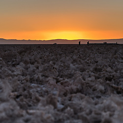 People come to watch flamengo's at sunset in one of the worlds biggest saltflats, Laguna Chaxa, Chile.