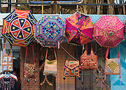 Umbrellas, purses, shawls for sale, at Lakeside, in Pokhara, Nepal.