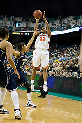 Virginia guard Monica Wright (22) shoots over Georgia Tech guard Jill Ingram (5).  The #4 seed/#25 ranked Virginia Cavaliers women's basketball team defated the #5 seed Georgia Tech Yellow Jackets 52-43 in the quarterfinals of the 2008 ACC Women's Basketball Tournament at the Greensboro Coliseum in Greensboro, NC on March 7, 2008.