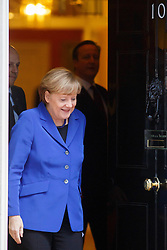 © licensed to London News Pictures. London, UK 27/02/2014. German Chancellor Angela Merkel leaving Downing Street after meeting British Prime Minister David Cameron on Thursday, 27 February 2014. Photo credit: Tolga Akmen/LNP