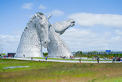 The Kelpies, at Grangemouth Falkirk, are 30m (98ft) tall horse head statues beside the Forth and Clyde Canal, in Helix park. The 300-ton sculptures were created by Glasgow artist Andy Scott and inspired by the shape shifting mythological creatures called Kelpies which are reputed to haunt the rivers and streams of Scotland.<br /> <br />  25 May 2015<br />  Image © Paul David Drabble <br />  www.pauldaviddrabble.co.uk
