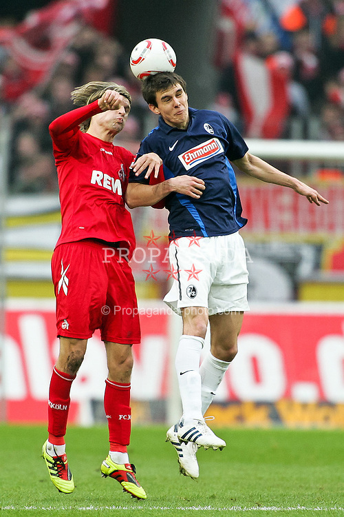 26.02.2010,  Rhein Energie Stadion, Koeln, GER, 1.FBL, FC Koeln vs SC Freiburg, 24. Spieltag, im Bild: Kopfball zwischen Martin Lanig (Koeln #5) (li.) und Johannes Flum (Freiburg #18) (re.)   EXPA Pictures © 2011, PhotoCredit: EXPA/ nph/  Mueller       ****** out of GER / SWE / CRO  / BEL ******