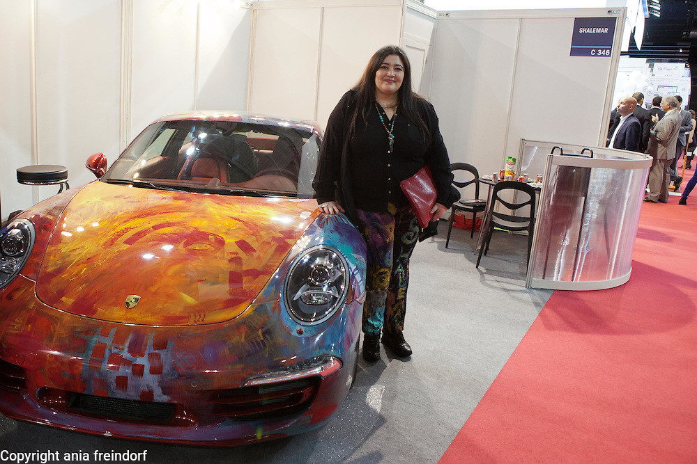 "Saudi artist Shalimar Sharbatly, ""Shalemar"" and her family, during the Salon Mondial Automobile. Her art painting on a Porsche car, Paris, France."