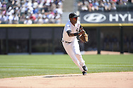 CHICAGO - JUNE 14:  Alexei Ramirez of the Chicago White Sox fields against the Kansas City Royals on June 14, 2014 at U.S. Cellular Field in Chicago, Illinois.   (Photo by Ron Vesely)