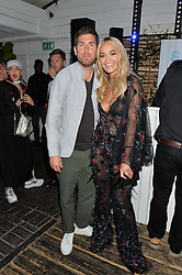 MAX LOUSADA Chairman & CEO, Warner Music UK and RITA ORA at the Warner Music Group & GQ Summer Drinks hosted in asociation with Quintessentially at Shoreditch House, Ebor Street, London on 6th July 2016.