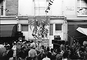 Artwork above crowd on All Saints Road, Notting Hill Carnival, London, 1989