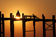 Sihilouettes at sunset on the U-Bain bridge in Myanmar.<br /> Photo by Lorenz Berna