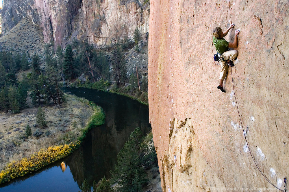 SMITH ROCK, OR - Climber, surfer, photographer, and cancer survivor Ben Moon climbs the route Rawhide, 5.11d, at Smith Rock State Park, Oregon. He is belayed by Kim Lambert.