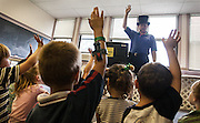 "Magician Jim plays a game with young children at an elementary school. ""I use my top hat as a visual cue to my audience which the majority of the time is children, to signify that there is something different and special about me,"" Jim said. ""Children are very good judge of character and if you don't like them, they sense it and it puts them off."""