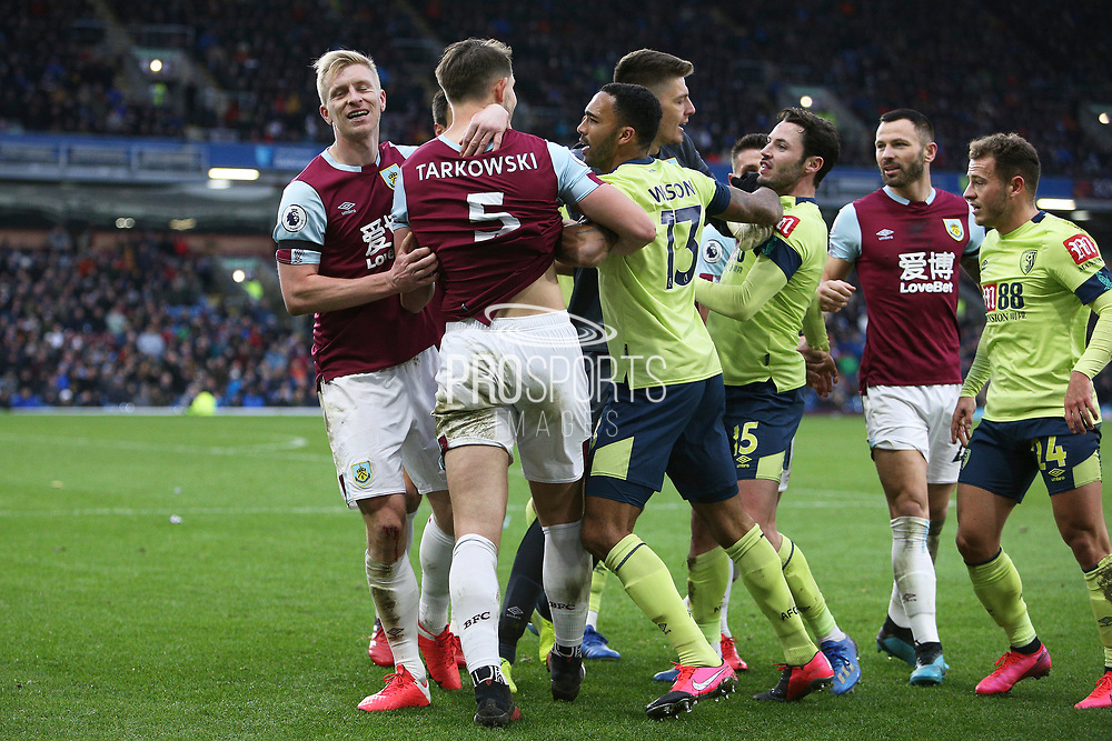 Bournemouth defender Adam Smith (15) and Burnley defender James Tarkowski (5) square up to each other  during the Premier League match between Burnley and Bournemouth at Turf Moor, Burnley, England on 22 February 2020.