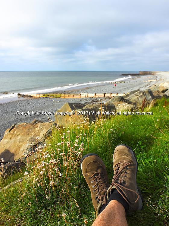 Walker's legs (lying down)<br /> Wales Coast Path to the southwest of Aberaeron<br /> Aberaeron<br /> Ceredigion<br /> Mid<br /> Walking