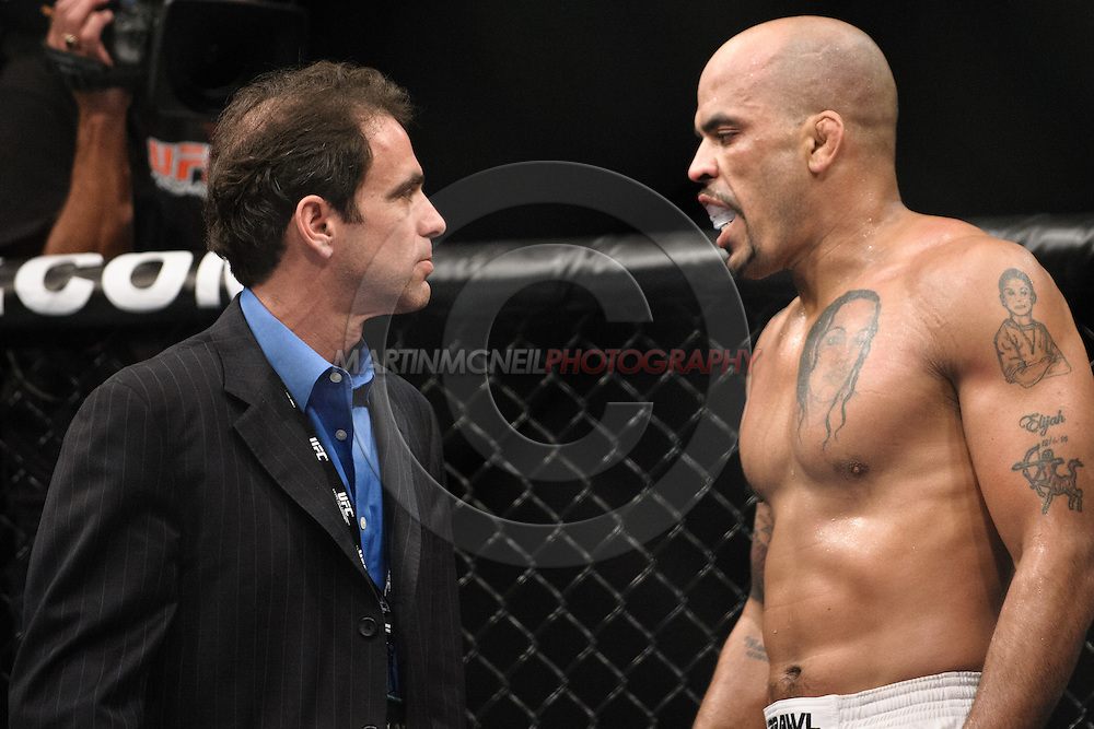 "SYDNEY, AUSTRALIA, FEBRUARY 27, 2011: Jorge Rivera (right) is checked by a medical official after being kneed to the head by Michael Bisping (not pictured) during ""UFC 127: Penn vs. Fitch"" inside Acer Arena in Sydney, Australia on February 27, 2011."