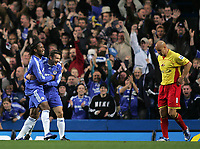 Photo: Lee Earle.<br /> Chelsea v Watford. The Barclays Premiership. 11/11/2006. Chelsea's Didier Drogba (L) is congratulated by Andriy Shevchenko after his first goal. Watford's Gavin Mahon looks dejected (R).