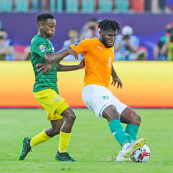 Franck Kessie of Ivory Coast shields the ball from Themba Zwane of South Africa during the 2019 Africa Cup of Nations Finals game between Ivory Coast and South Africa at Al Salam Stadium in Cairo, Egypt on 24 June 2019  <br /> Photo : Icon Sport