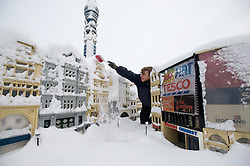© under license to London News Pictures. 21/12/2010. A snow covered Lego London at Miniland, Legoland Windsor this morning (21/12/2010) following further snowfall last night. Pictured is model maker Joel brushing snow off Piccadilly Circus. Photo credit should read: London News Pictures