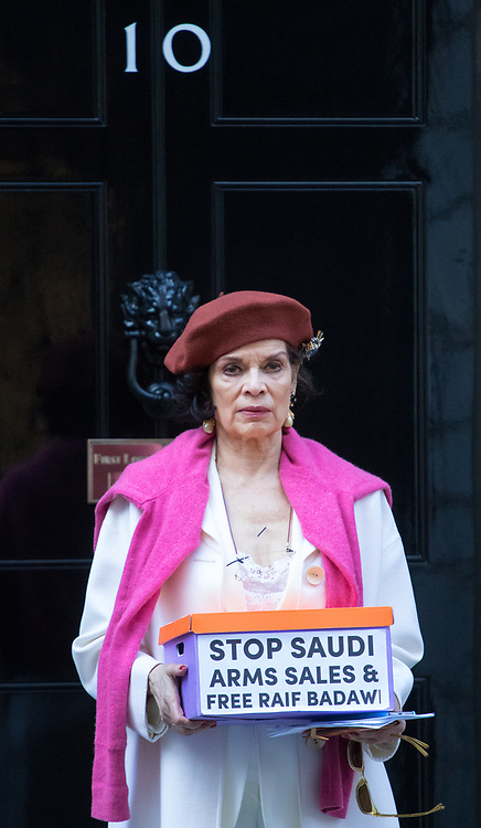 Downing Street, London, March 15th 2017. Bianca Jagger joins Bianca Jagger will join Peter Tatchell and others to hand in a 159,000-signature petition that urges the UK government to halt arms sales to Saudi Arabia over its war crimes in Yemen and its jailing of blogger Raif Badawi and other political prisoners, to Prime Minister Theresa May at 10 Downing Street. PICTURED: Bianca Jagger