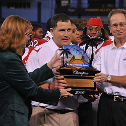 Dec 20, 2009; St. Petersburg, Fla., USA; Rutgers head coach Greg Schiano is awarded the champion's trophy following Rutgers' 45-24 victory over Central Florida in the St. Petersburg Bowl at Tropicana Field.