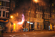 Firefighters tackle the blaze after Party Superstore set alight by rioters during a night of rioting at Clapham junction South London Party Superstore set alight by rioters during a night of rioting at Clapham junction South London