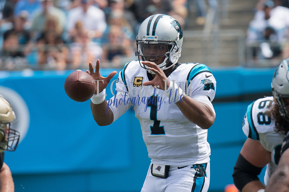 Cam Newton(1) is focused on the ball in the New Orleans Saints 34 to 13 victory over the Carolina Panthers.
