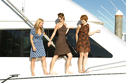 Three women walking on a yacht