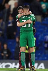 Manchester City's John Stones greets goalkeeper Ederson after the final whistle during the Premier League match at Stamford Bridge, London.