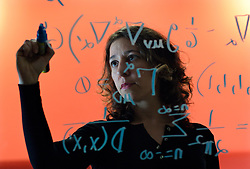 UK ENGLAND OXFORD 3DEC03 - Research Fellow in Astrophysics at Oxford University, Janna Levin writes a mathematical model on the glass wall of her office. Last year she published her first book titled 'How the Universe Got Its Spots' - Diary of a Finite Time in a Finite Space - in which she argues her mathematical model of a finite universe.<br /> <br /> jre/Photo by Jiri Rezac<br /> <br /> © Jiri Rezac 2003