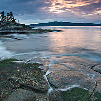 Coastline of Saltspring Island, part of the Gulf Islands, in British Columbia, Canada, at dawn, viewed from Ruckle Provincial Park.