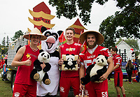 "Ryan Dee, Patrick Duggan and Tyler Richter with some ""Panda Power"" (Mandy Stefanik) as they get ready to march with the Junior class during Laconia High School's Homecoming parade.  (Karen Bobotas/for the Laconia Daily Sun)"