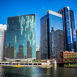 Chicago cityscape with downtown city buildings along the Chicago River South Branch split. Photo is high resolution and was taken in May 2012.