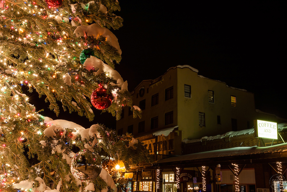 """Snowy Christmas Tree in Truckee 2"" - This snow covered Christmas tree was photographed in Downtown Truckee, California with the Sierra Tavern in the background."