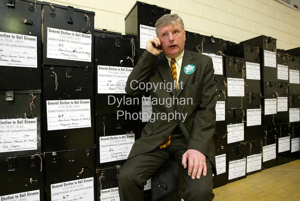 18/5/2002.Fianna Fail candidate Liam Alyward pictured on the phone to MJ Nolan at the count centre in the Community Hall in Thomastown County Kilkenny yesterday as he awaits the results of the first count..Picture Dylan Vaughan