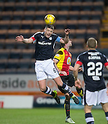 Dundee&rsquo;s Darren O&rsquo;Dea heads clear from Partick Thistle's Kris Doolan - Dundee v Partick Thistle in the Ladbrokes Scottish Premiership at Dens Park, Dundee.Photo: David Young<br />