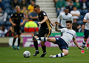 Shaun Williams of Millwall is tackled by Seán Maguire of Preston North End during the EFL Sky Bet Championship match between Preston North End and Millwall at Deepdale, Preston, England on 23 September 2017. Photo by Paul Thompson.