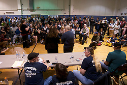 Representatives of Safehouse react to questions and concerns of plans for a safe injection site in the neighborhood during a community meeting at Heitzman Rec center, on Thursday. (Bastiaan Slabbers for WHYY)