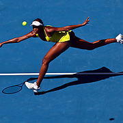 Venus Williams of the US hits the ball during her fourth round match against Francesca Schiavone of Italy at the Australian Open Tennis Tournament in Melbourne, Australia, 25 January 2010.