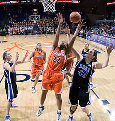 Virginia Cavaliers Guard Monica Wright (22)shoots over Duke Blue Devils Center Alison Bales (43).  The University of Virginia Cavaliers lost to the #1 ranked Duke University Blue Devils 76-61 at the John Paul Jones Arena in Charlottesville, VA on February 2, 2007.