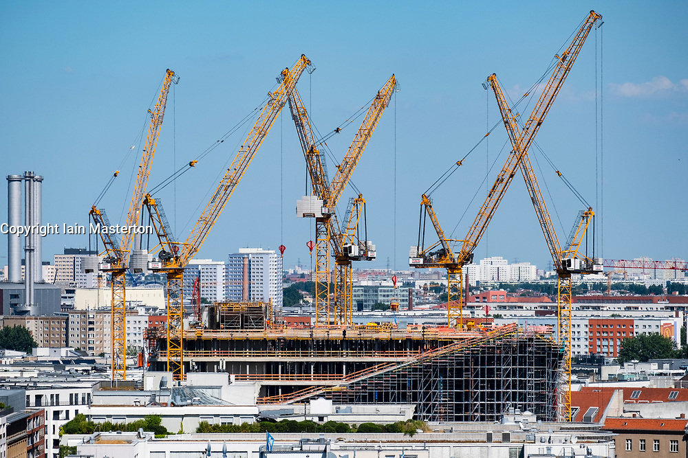 Skyline of Berlin looking towards tower cranes of construction site in Mitte, Berlin, Germany