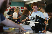 Denise Ratliff makes her last purchase Saturday, April 16, 2016 from Pegasus Records in Florence, Ala. The store was open for over 30 years and closed Saturday.