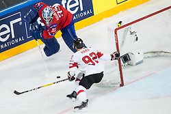 Henrik Haukeland of Norway vs Gaetan Haas of Switzerland during the 2017 IIHF Men's World Championship group B Ice hockey match between National Teams of Norway and Switzerland, on May 7, 2017 in Accorhotels Arena in Paris, France. Photo by Vid Ponikvar / Sportida