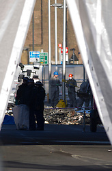 © Licensed to London News Pictures. 17/01/2013. London, UK. Wreckage seen in a road near Vauxhall after a helicopter hit a crane attached to the St George's Wharf development in Vauxhall, London, yesterday (17/01/13). 2 (two) people, including the pilot, died as a result of the incident and a further 11 (eleven) injured after the Augusta 109 helicopter collided with the crane in heavy mist showering wreckage onto cars below. Photo credit: LNP