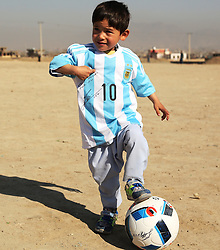 Afghan boy Murtaza Ahmadi poses for photos wearing a new jersey signed by Argentina soccer star Lionel Messi in Kabul, capital of Afghanistan, Feb. 26, 2016. Five-year-old Murtaza Ahmadi who became a social media hit after wearing a plastic bag bearing Lionel Messi's number 10 finally received the real thing which was sent by the Argentine footballer himself. EXPA Pictures © 2016, PhotoCredit: EXPA/ Photoshot/ Rahmat Alizadah<br />