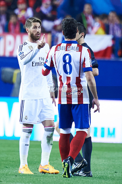 Raul Garcia and Sergio Ramos (Real Madrid F.C.) in action during the Champions League, round of 4 match between Atletico de Madrid and Real Madrid at Estadio Vicente Calderon on April 14, 2015 in Madrid, Spain