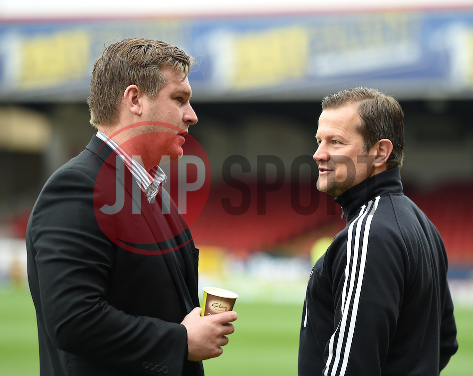 Milton Keynes Dons Manager, Karl Robinson and Swindon Town Manager, Mark Cooper chat ahead of Sky Bet League One clash at The County Ground - Photo mandatory by-line: Paul Knight/JMP - Mobile: 07966 386802 - 04/04/2015 - SPORT - Football - Swindon - The County Ground - Swindon Town v Milton Keynes Dons - Sky Bet League One