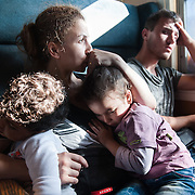 Noon, Sunday 13th of September 2015. Sham and Bisan sleep on Aysha's lap. They are on a special train just for refugees and immigrants from Gevgelija to Slanishte , across the Republic of Macedonia. The train was packed,when Aysha got in. All the seats of the car were taken by young men from Iraq and Afghanistan. Aysha was displeased but she didn't protest. Somebody from the train said to a man to give his seat for Aysha, he did so reluctantly. There was no toilet on the train and no one had any idea were it goes or how long the journey will be.