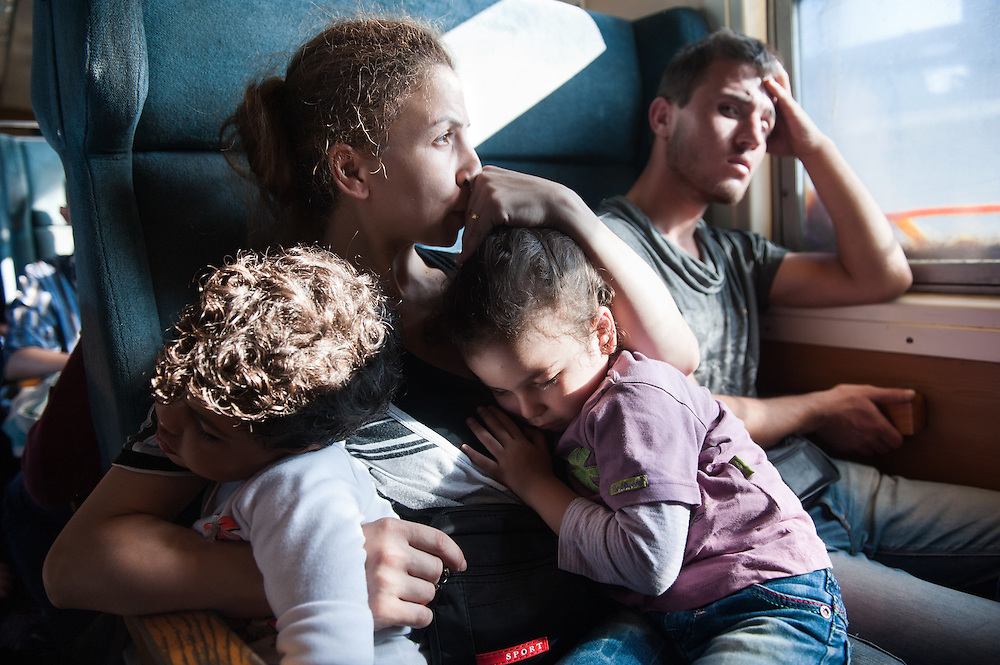 Noon, Sunday 13th of September 2015. Sham and Bisan sleep on Aysha's lap. They are on a special train just for refugees and immigrants from Gevgelija toSlanishte , across the Republic of Macedonia. The train was packed,when Aysha got in. All the seats of the car were taken by young men from Iraq and Afghanistan. Aysha was displeased but she didn't protest. Somebody from the train said to a man to give his seat for Aysha, he did so reluctantly. There was no toilet on the train and no one had any idea were it goes or how long the journey will be.