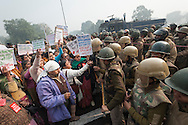 23rd Dec. 2012. Protesters and police face off during a demonstration in central New Delhi. A large group of activists were angry about the injustice of women's rights in the aftermath of a victim of gang-rape in the Indian capital.