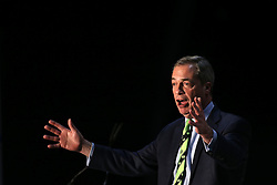 © Licensed to London News Pictures. 4/03/2016. Belfast, Northern Ireland, UK.  Nigel Farage MEP (Leader, UKIP) speaks to Brexit supporters, as they gather in Belfast for a Grassroots Out rally. Speakers included Jim Allister MLA (Leader, Traditional Unionist Voice) Sammy Wilson MP (DUP) Kate Hoey MP (Labour), Peter Bone MP (Conservative) Tom Pursglove MP (Conservative) David McNarry MLA (Leader, UKIP NI) Graham Gudgin (Economist) Kevin McCorry (People's Movement)       Photo credit : Paul McErlane/LNP