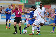 referee Gavin Ward gets in the way of AFC Wimbledon midfielder Jake Reeves (8) and Bolton Wanderers midfielder Mark Davies (16) during the EFL Sky Bet League 1 match between AFC Wimbledon and Bolton Wanderers at the Cherry Red Records Stadium, Kingston, England on 13 August 2016. Photo by Stuart Butcher.