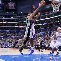 18 February 2014: San Antonio Spurs power forward Tim Duncan (21) goes for the layup over Los Angeles Clippers center DeAndre Jordan (6) during the San Antonio Spurs 113-103 victory over the Los Angeles Clippers at the Staples Center, Los Angeles, California, USA.